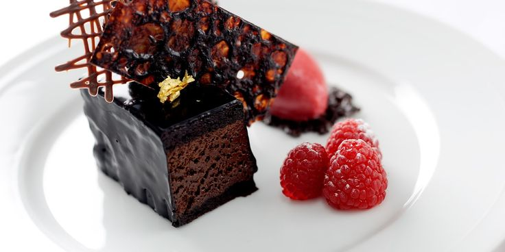 Celebrated chef, William Drabble, pairs a chocolate mousse cake with raspberry sauce and raspberry sorbet in this chocolate mousse cake recipe