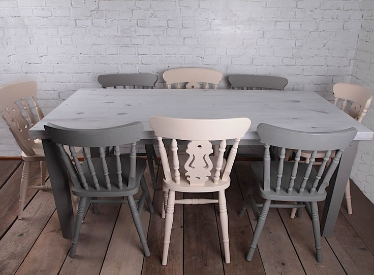 Vintage, farmhouse, country home, shabby chic style dining table & chair set hand painted using autentico chalk based paints. This vintage upcycled furniture set was given a white wash effect on the table top to ensure all the beautiful knots and detail in the pine was still visible. The chairs where painted in complimenting creams and greys. Finally it was finished with a clear protective wax to keep it looking great for years to come. You can view more of my work at www.RelovedHome.co.uk