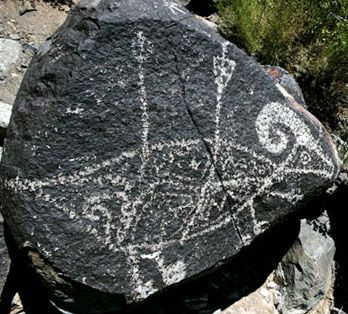 Camping Road Trip through Southern New Mexico - Its contrasting, yet stunning landscapes, where sand dune deserts meet alpine peaks provide breathtaking scenery, great hiking, camping & RVing opportunities. (Indian rock art of a Ram stuck with arrows)