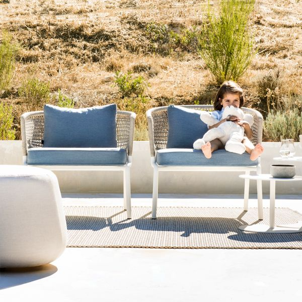 CTR Club Chair with white powder coated stainless steel and linen weaving. Outdoor cushions in Natté Ocean.