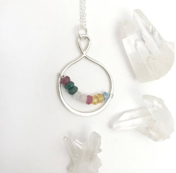 Mothers Day Gift for Grandma this personalized birthstone necklace. A beautiful sterling silver teardrop holds up to 10 beautiful, faceted birthstones of your choice. All is suspended from a delicate sterling silver chain. This is the perfect gift for mothers and grandmothers!