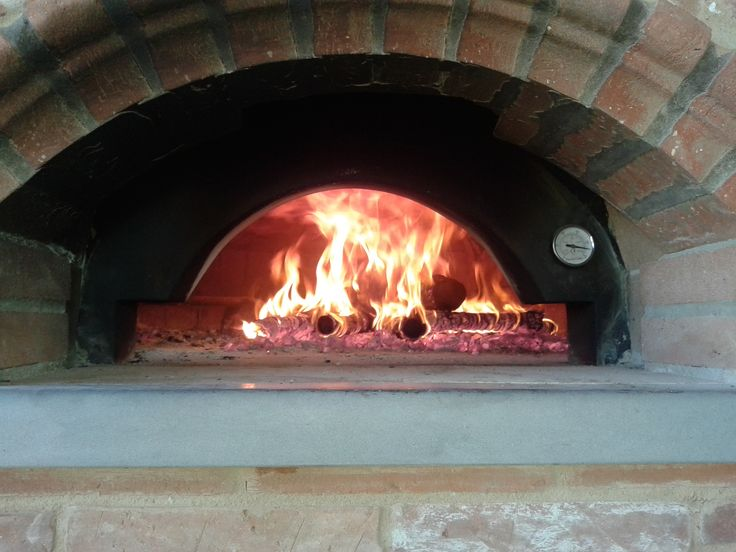 Wedding reception - Traditional wood oven by the pool for special preparations - like pizzas for children