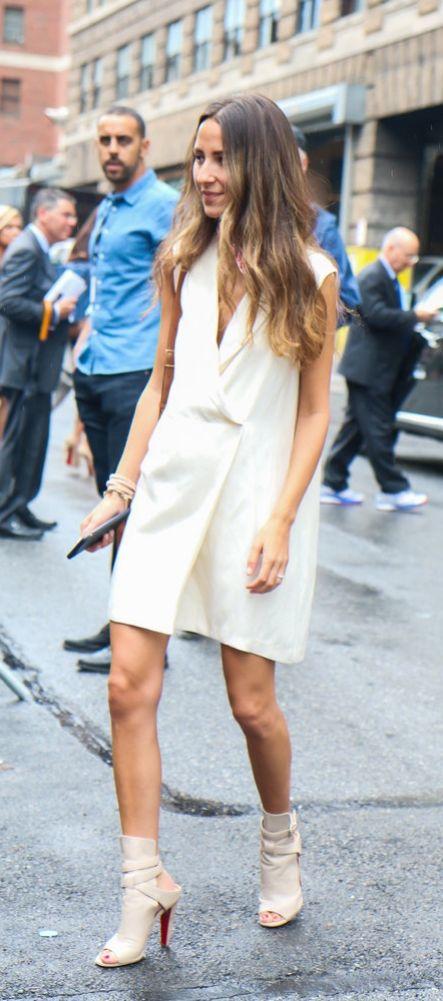 Arielle Noa Charnas of SomethingNavy in a tuxedo vest dress.