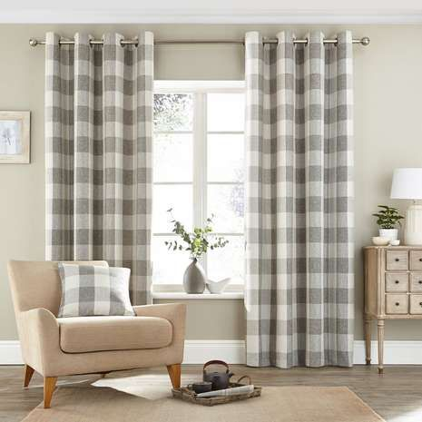 Designed with a check pattern and an elegant woven texture, these ready made natural curtains are fully lined to…