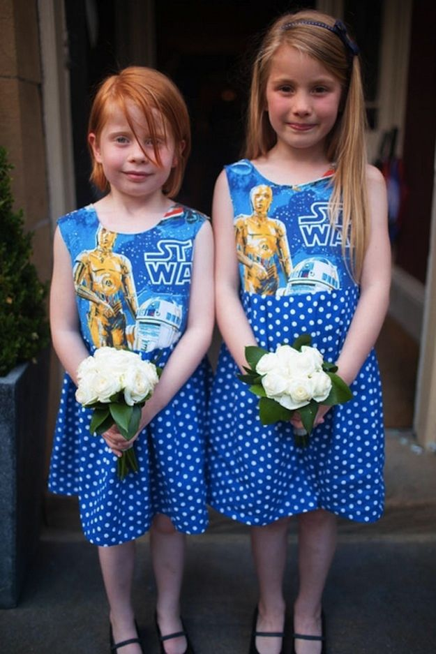 These bridesmaids are wearing dresses made from vintage Star Wars fabric, commissioned by the bride from the Rusty Cuts Etsy shop. Matching flower girls.