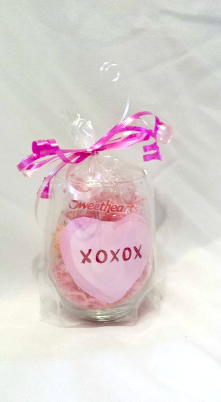 Valentine's Day Conversation Heart Stemless Pink Wine Glass XOXOXO. Stemless Wine glass gift packaged filled with conversation hearts and wrapped with ribbon. Pink heart hand painted with XOXOXO perfect valentines gift. Hand wash recommended . We ship all glass priority mail.