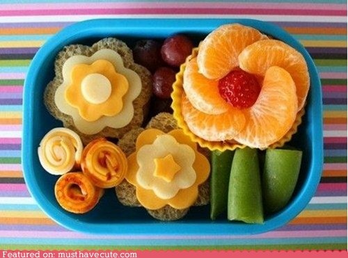From Must Have Cute. I just bought a bento box, so expect to see a lot of these. Not that I'll be able to actually make em' like this, but hey, a girl can dream!