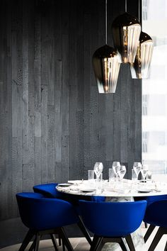 Klein blue dining chairs and an amazing ceiling light in brass |www.bocadolobo.com #diningroomdecorideas #moderndiningrooms