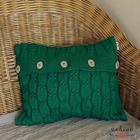 A hand knitted decorative pillowcase with braided design for pillows. Thanks to its green color and simple wood buttons it looks a lot natural and can contribute to the Christmas atmosphere. Its a soft, fluffy decoration with a special touch to any armchair, sofa or bed. Its also a perfect gift idea.  • SIZE | 40x40 cm / 15,7X15,7 inches • FABRIC | 80% acryl, 20% wool • COLOR | green • 100% handmade • Button closure that makes it easy to insert the pillow • The pillow case is washable at...