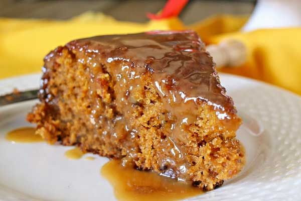 Simple recipe for Sticky Toffee Pudding- a rich, pudding-like English cake drizzled with caramel sauce.