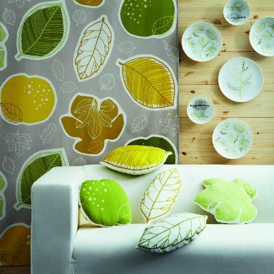 Love the leaf-shaped pillows using our new GURINE by-the-yard fabric! ($5.99/yd) - image via 2.bp.blogspot.com