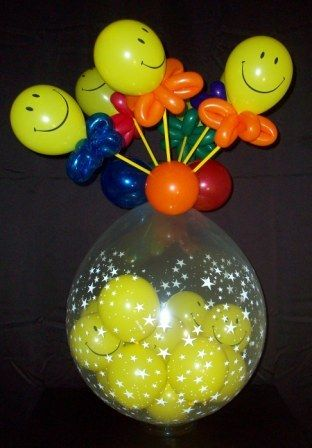 """All Smiles!-  Brighten someone's day with this cheerful collection of smiley-face balloons on top and inside this 18"""" star print balloon. They're perfect to send for  get-well wishes or just because!"""