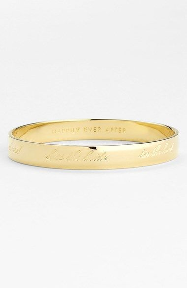"""Free shipping and returns on kate spade new york 'idiom - happily ever after' bangle at Nordstrom.com. Fairytale-worthy phrases engrave a polished, cornered bangle fit for a bride. The cursive inscriptions read, """"cue the confetti, cheers!, kiss the bride, tie the knot, toss the bouquet, cut the cake."""""""