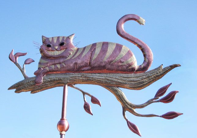 The Cheshire Cat on a Branch Weather Vane is handcrafted of copper and brass with optional gold leafing. Metals & design can be customized upon ordering.