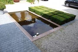 Strakke privé-tuin te Hollebeke