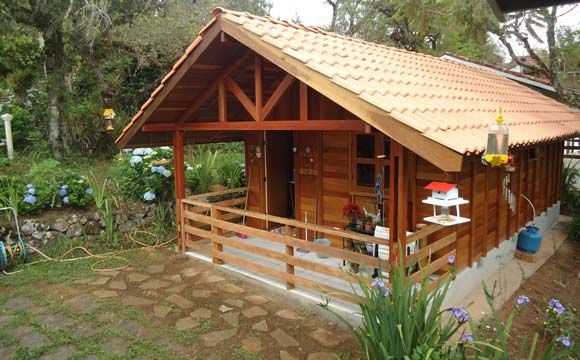 Casa de madeira com varanda pode ficar um pouco mais cara