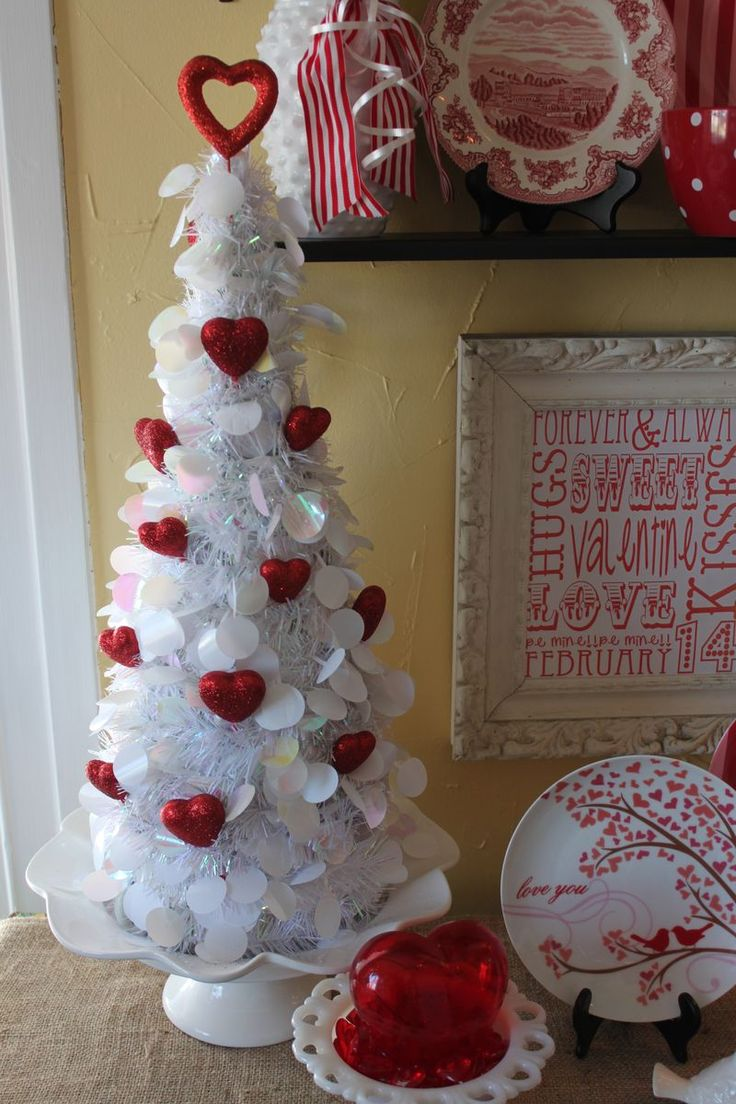 Cute Valentine Tree Inspiration...so easy! Tree was clearance at WM and she used Dollar store heart pics, love this!