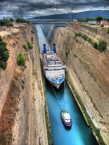 When you stand on the bridges that stretch over this the Corinth Canal, it appears about 14 feet wide and not that impressive…but looks can be deceiving…