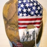 """Masks of Service"": Stories of military service told through masks @ Olympic College."