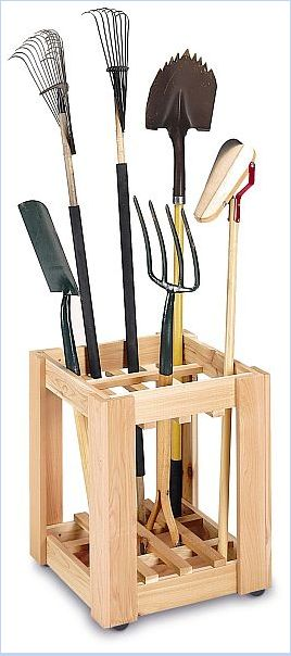 Love this way of organizing garden tools and supplies!  You can make this yourself so easy, find something similar at a flea market (Old wine rack turned sideways?).