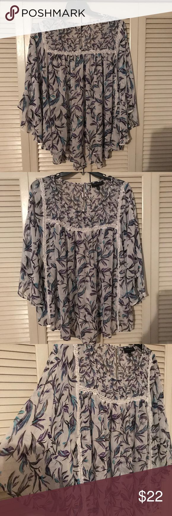 Lane Bryant Blouse 22/24 SO FLATTERING in my opinion. Lightweight. Pull on with Batwing Kimono like sleeves. Incredibly flowy with swing movement. Abstract designs in purple, teal, and blue on white background. Crochet inset details. Fits very much like a Torrid blouse. Size 22/24 but can easily fit 26/28 or 3x 4x. Like New Condition. Lane Bryant Tops Blouses