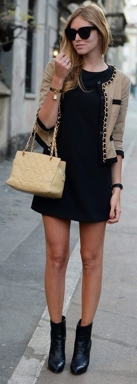 Beige collarless jacket with chain and black edging + black dress and boots + nude handbag