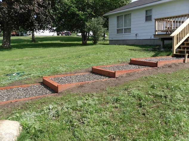How to win over your sloped backyard in two days for Sloped yard solutions