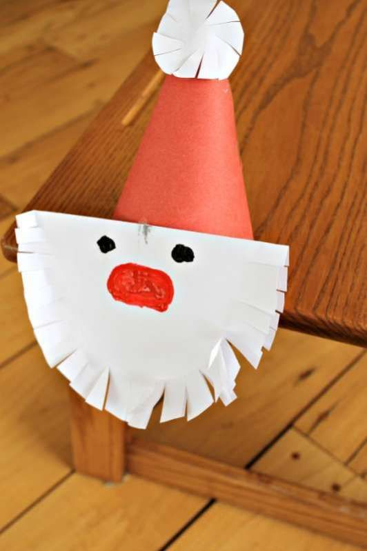 This Santa craft is great cutting practice for preschoolers. They'll practice holding scissors and cutting while creating this cute Christmas Santa craft.