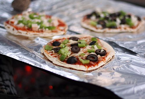 campfire-flatbread-pizzas & other camping recipes at this site---flatbread or boboli crust or pre-cook dough