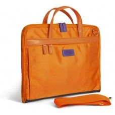 Small Moda Laptop Bag, It is suitable for size laptops or perhaps a tablet device such as an iPad. Features include color contrast leather handles (that can be hidden in the side pouches when using the strap), an additional matching shoulder strap (optional use). Magnetic closure on flaps on both sides and additional zip on front side for extra storage.  8 colorways. Perfect for the Ipad. $90 Call Campo Marzio of Charleston to order 843-718-3414.