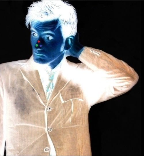 Stare at the red dot for 30 seconds and then look at a blank white wall. BAM full color Tennant. Weird. Didn't expect that to actually work.