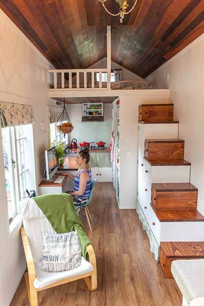 Instead of installing a ladder up to the bedroom, this couple outfitted a staircase with drawers under the steps. In the kitchen, a pantry shelf was built deep enough to hold large mason jars.