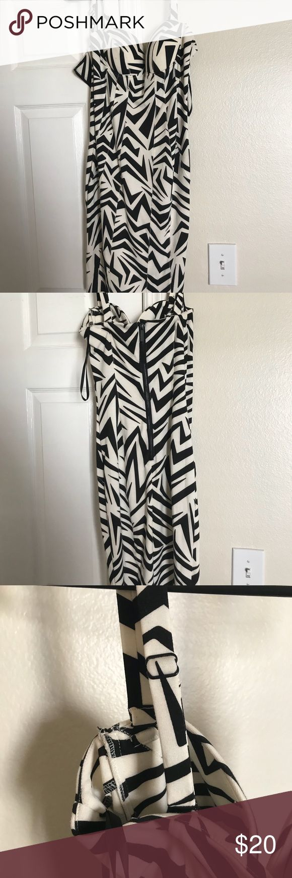 KARDASHIAN KOLLECTION form fitting dress KARDASHIAN KOLLECTION form fitting dress High quality thick material  Form fitting Material does have a stretch  Black & white Adjustable straps Zipper in the back About knee length ( right above the knee on taller women) Woman's sizeS Kardashian Kollection Dresses Midi