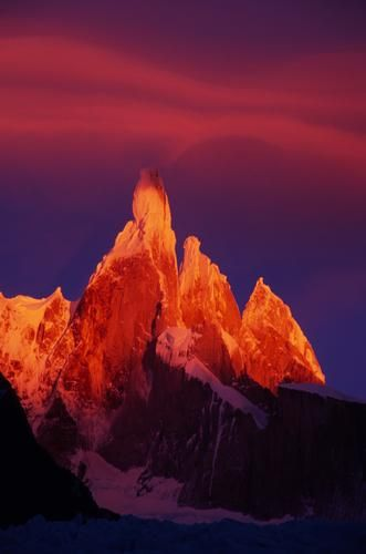 Cerro Torre, Patagonia, Argentina. Love how the the peak looks like it's giving off the cloud
