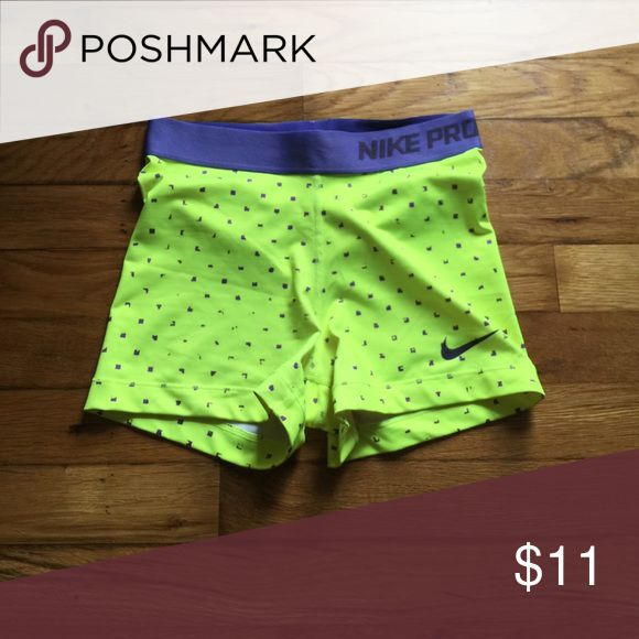 Nike spandex shorts Nike neon and purple spandex shorts. Size s. No tears, holes, or stains. Nike Shorts
