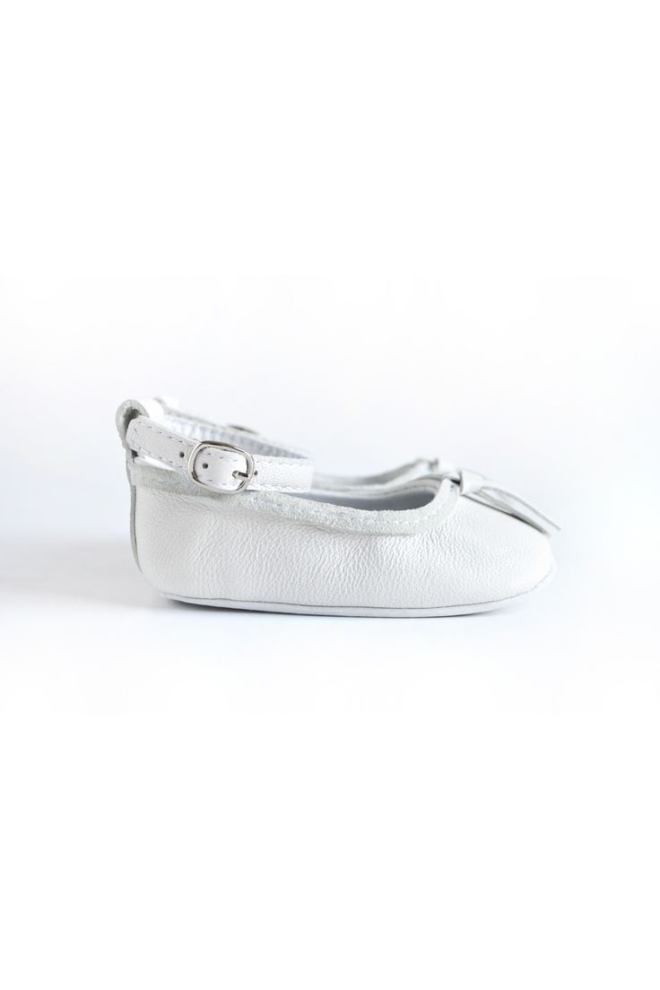 White leather baby ballerinas with ankle strap by MiniMo.