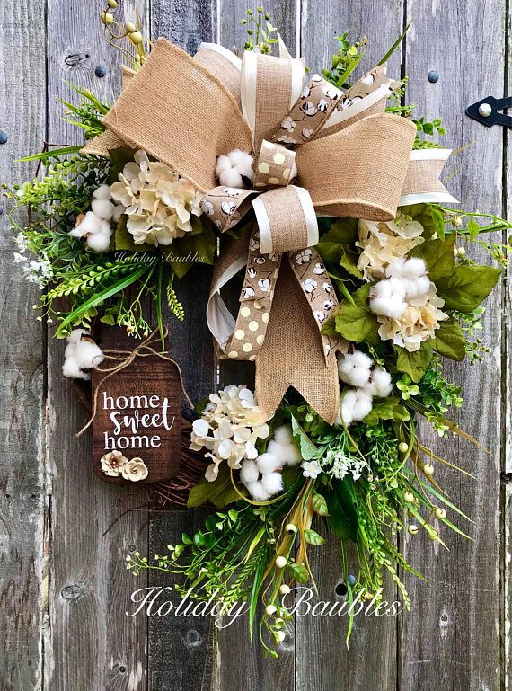 """Home Sweet Home Mason Jar Grapevine  25"""" This beauty can be hung all year round inside or outside.  Adds a touch of farmhouse feel! Designed on a Grapevine base Layered in boxwood, grassy greenery for fullness. Cream hydrangeas, cream berries , white floral burst and a touch"""