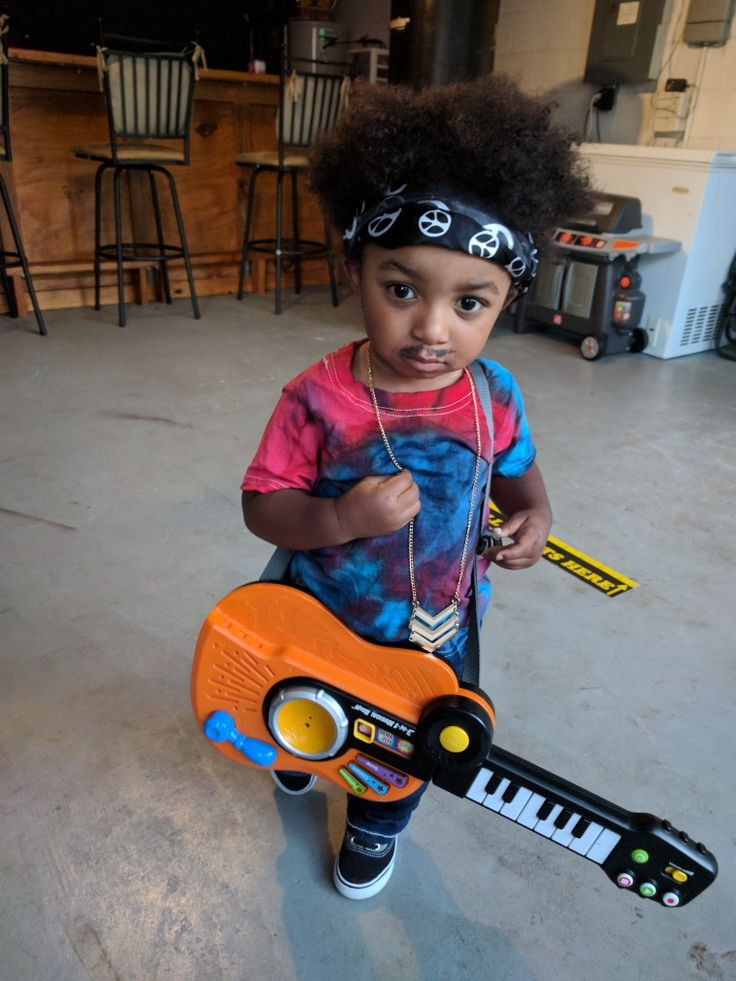 Our son as Jimi Hendrix for Halloween. This is so awesome!