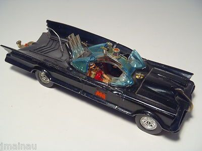 Corgi Batmobile. I got my brother's old one, it was great - especially the little plastic flames that used to go in and out of the exhaust pipe as you pushed it along :)
