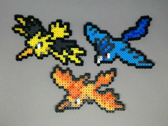 Handmade perler Pokemon creations! Feel free to request a shiny version of the Pokemon for no extra charge!  Here are the sizes: Articuno - 4in H x 4.75in W Zapdos - 3.75in H x 5.25in W Moltres - 3.5in H x 5in W  When finished with a necklace, the chain is silver plated and closed with a lobster clasp.