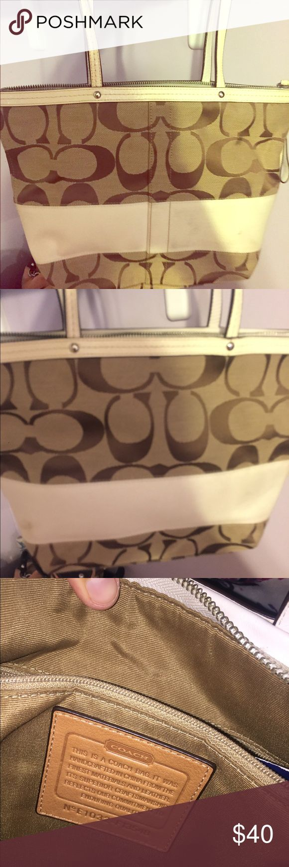 Tan Coach Tote This tan canvas coach tote bag is slightly used. There is a very small dark mark on the white stripe of the bag. No damage to the inside Coach Bags Shoulder Bags