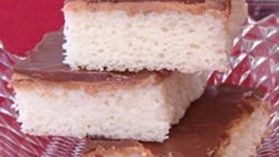 Baked in a 10x15 inch jelly roll pan, Tandy Cake is a yellow cake with a layer of peanut butter and a hard chocolate glaze. This recipe takes a couple of hours to make but it's worth it! It tastes so good!