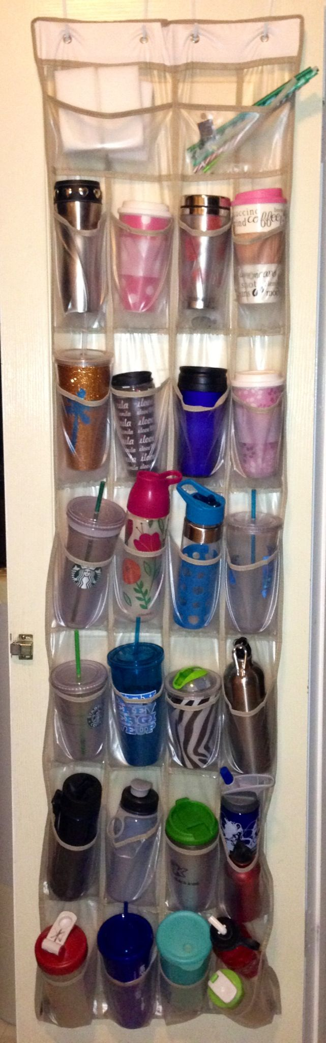 Stroke of genius! Hanging shoe rack on pantry door to store coffee tumblers and reusable water bottles! Clears out the shelves and cabinets. Instant space!