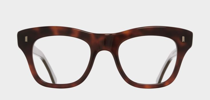 A classic upswept square optical frame featuring a heavy brow and patterned temple core. Same style group as 0772, 1221.