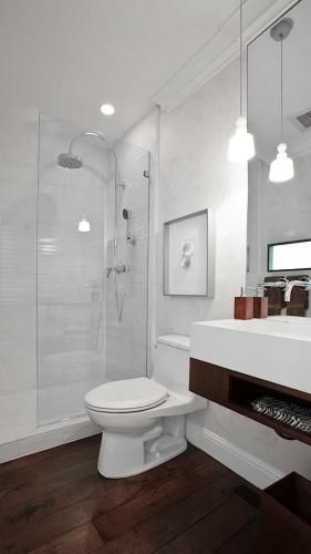 Love the wood floor in this white bathroom