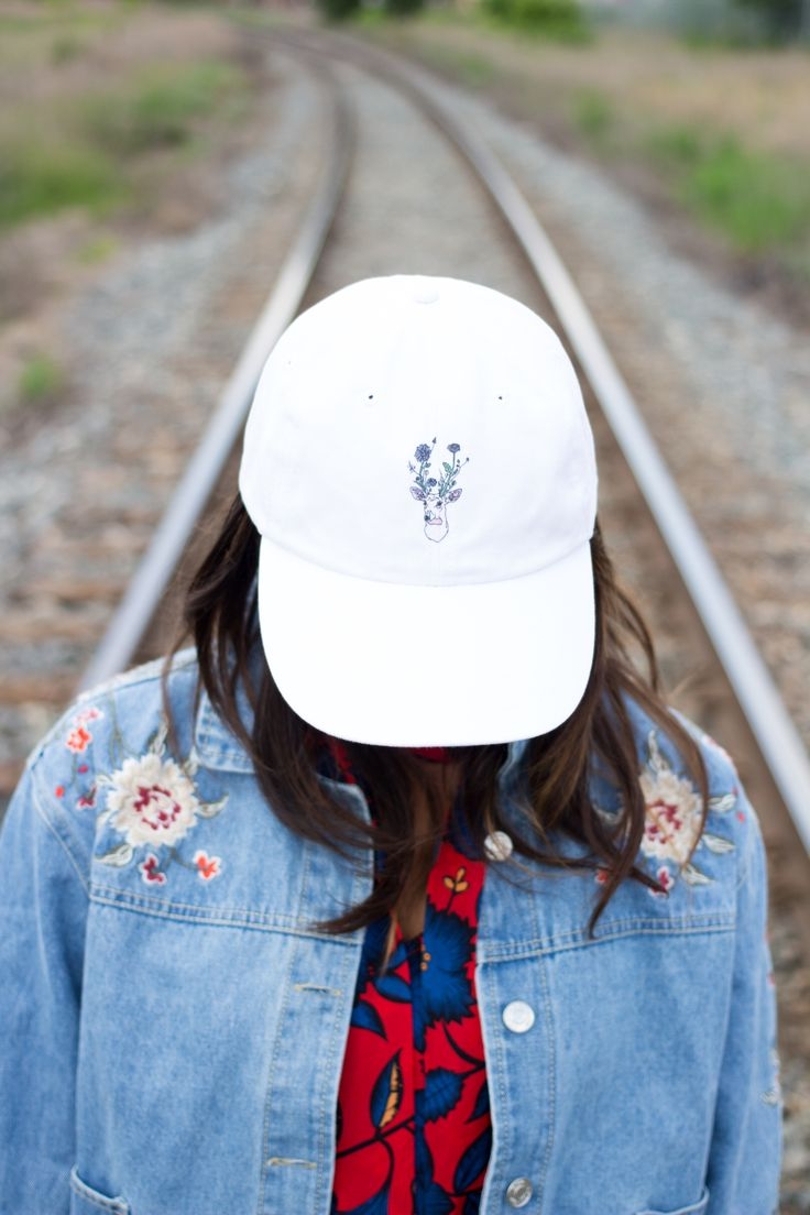 Brand new styles: white baseball caps and embroidered jean jackets available from Canadian fashion designer. Follow @marisapclark on Instagram.