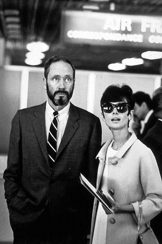 The actress Audrey Hepburn photographed with her husband Mel Ferrer (actor, dialogue coach and film director) at the Orly Airport (in French: Aéroport de Paris-Orly), in Paris (France).