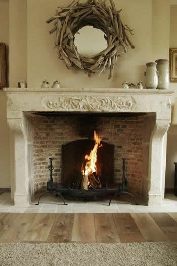 This fireplace is simplicity at it's best - stone mantel, brick back and a black fire basket