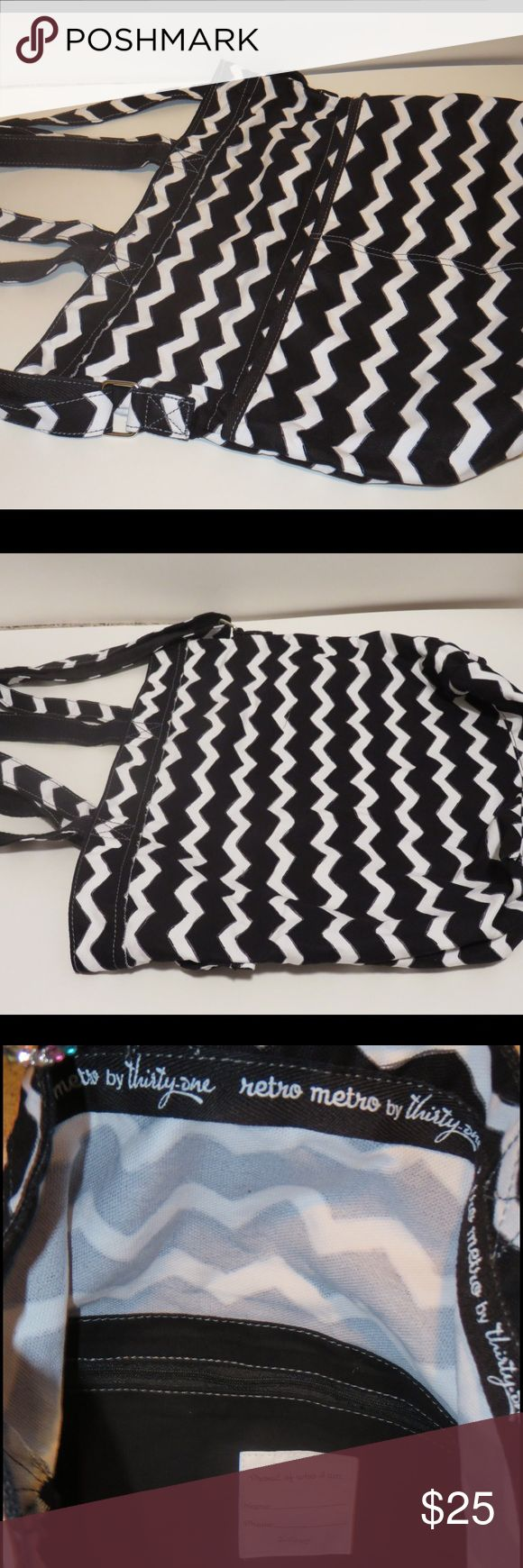 Brand new Thirty one retro metro bag This is a black and white retro metro bag from thirty-one. One side of the outside has two pockets and the other side has zero. There is a zipper pocket on the inside. This bag has handles as well as an adjustable shoulder strap. This is brand new, never used! thirty-one Bags Totes