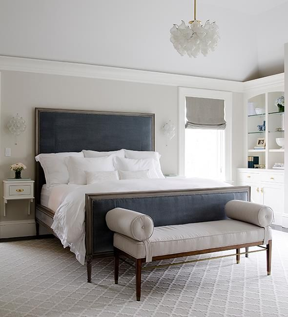 Gray bedroom with blue velvet headboard